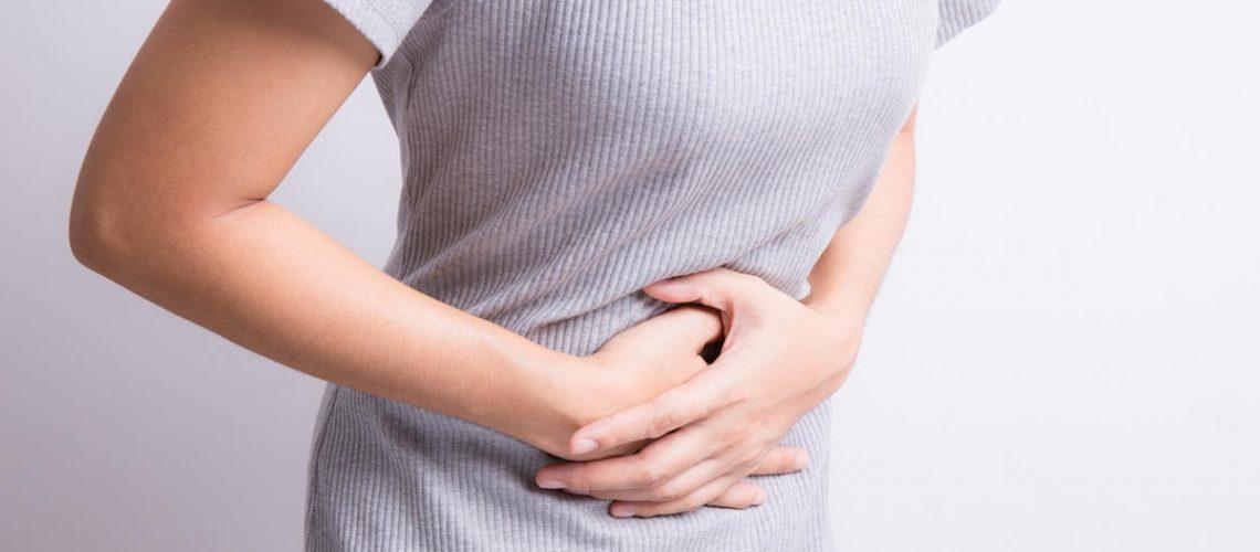 asian woman having stomachache